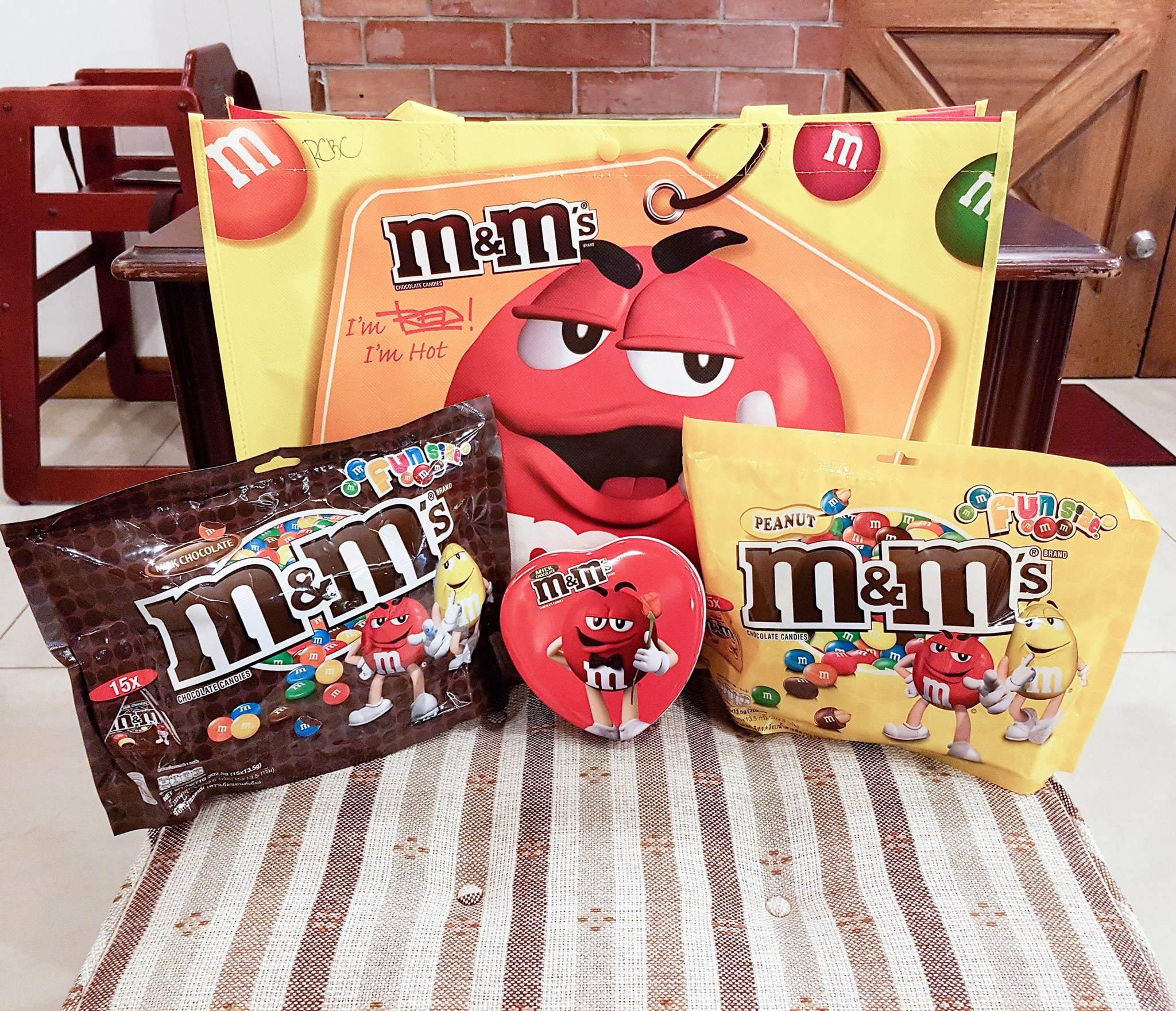 set of chocolates for valentines day here is a party pack of regular and peanut mms plus a heart shaped can which you can give to your girlfriend